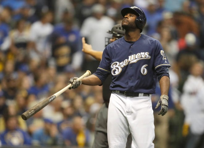 A disappointed Lorenzo Cain starts heading out to his position in center field after striking out against the Rockies to end the Brewers' half of the seventh inning during Game 2 on Friday at Miller Park.