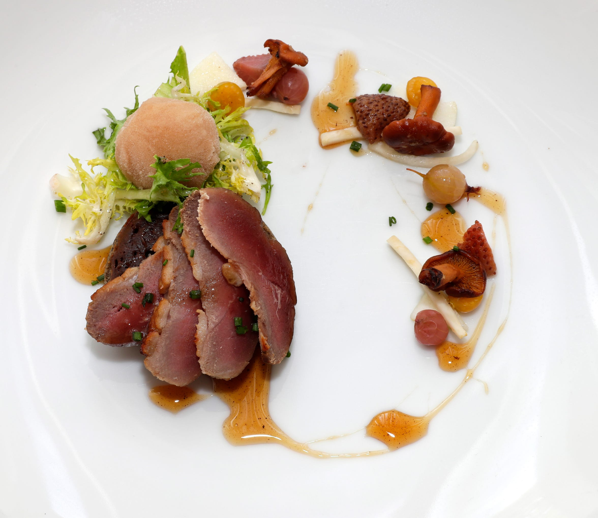 An appetizer in fall at Sanford, 1547 N. Jackson St., was smoked duck breast with buckwheat blini, birch sorbet and forest fruit.