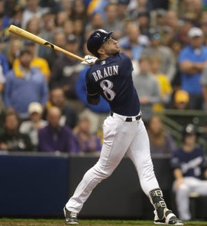 Ryan Braun sends a lazy fly ball to center field for the final out of the third inning to end a bases-loaded threat by the Brewers in Game 2 of the NL Division Series against the Rockies on Friday at Miller Park.