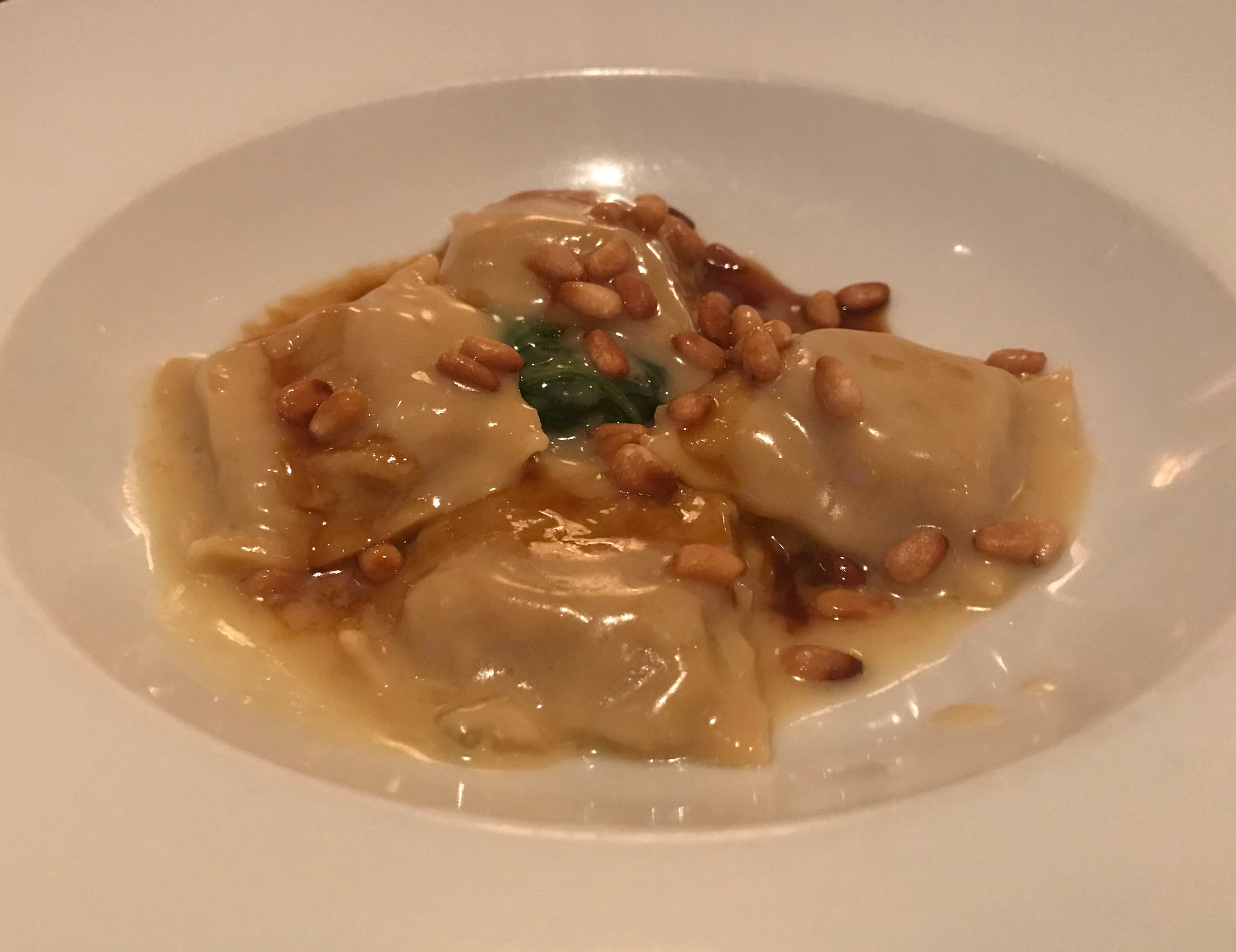 At Bacchus, 925 E. Wells St., delicate veal ravioli is served as a first course, with spinach, pine nuts, veal juices and ultra-creamy butter fonduta.