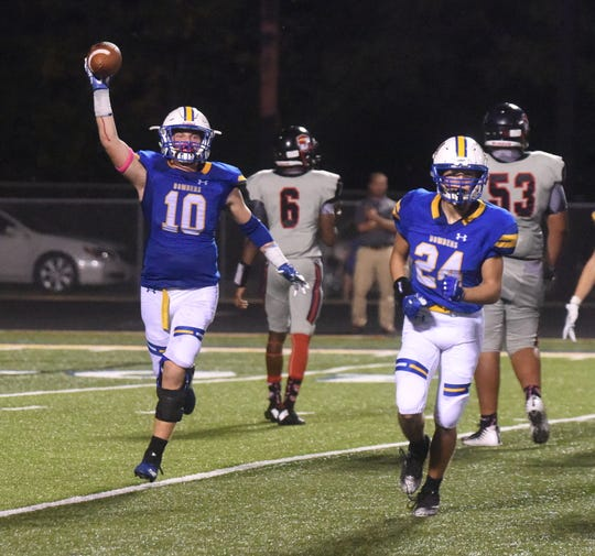 Mountain Home's Hunter Schad (10) celebrates recovering a fumble against Jacksonville.