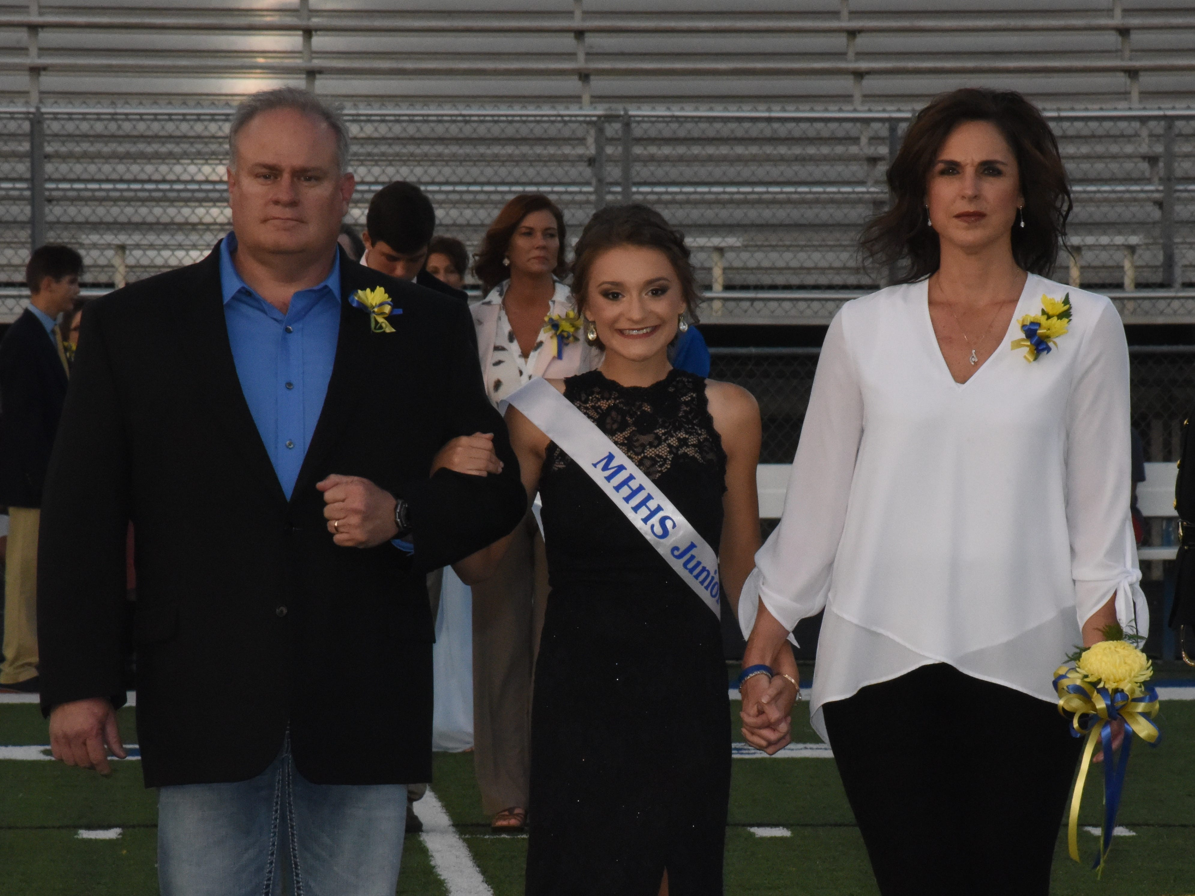 Junior maid Sydney Czanstkowski and her escorts in memory of Hayden Padgett, Brian Padgett (left) and Michelle Padgett.