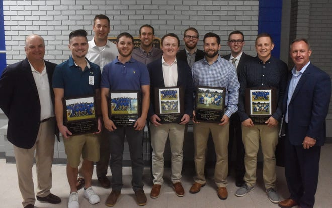 The 2006 and 2007 Mountain Home golf teams were inducted into the MHHS Athletic Hall of Honor on Saturday. Members who were at the ceremony are: (front row, from left) coach Adam Carney, Ryan Williams, Landon Booy, Jake Strother, Weston Monger, Cory Bramlett, coach Brad Morris; (second row) Clayton Brinza, Brad Simons, Seth Sullivant and Richard Zimmerman.