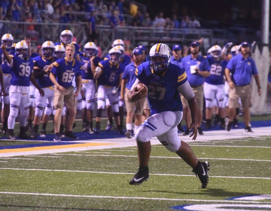 Junior Williams runs to the end zone on a first-half touchdown catch on Friday night.