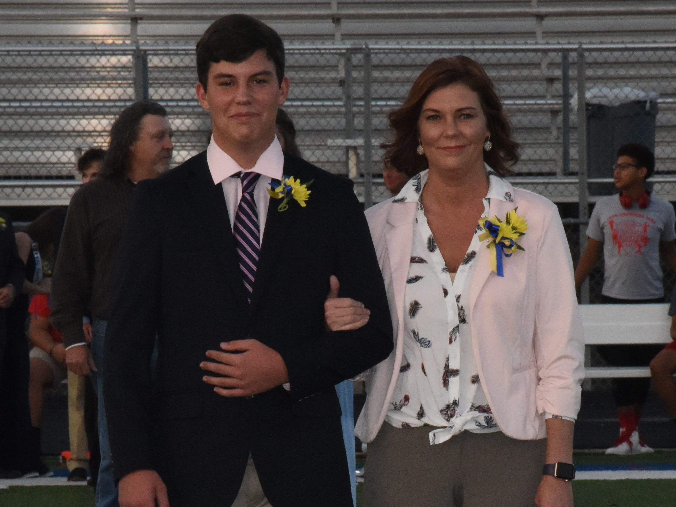 Junior knight Miles O'Brien and his mother, Carie O'Brien.