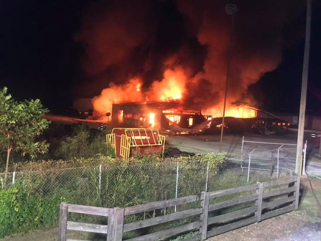 An early morning blaze engulfed the Feed Lot on Meriwether Road
