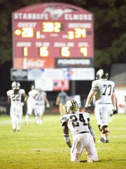 Wetumpka's Dvenio Davis drops to his knees after the ball was stripped from him and Stanhope's Marlon Hunt scored a touchdown giving the mustangs the lead late in the fourth quarter.