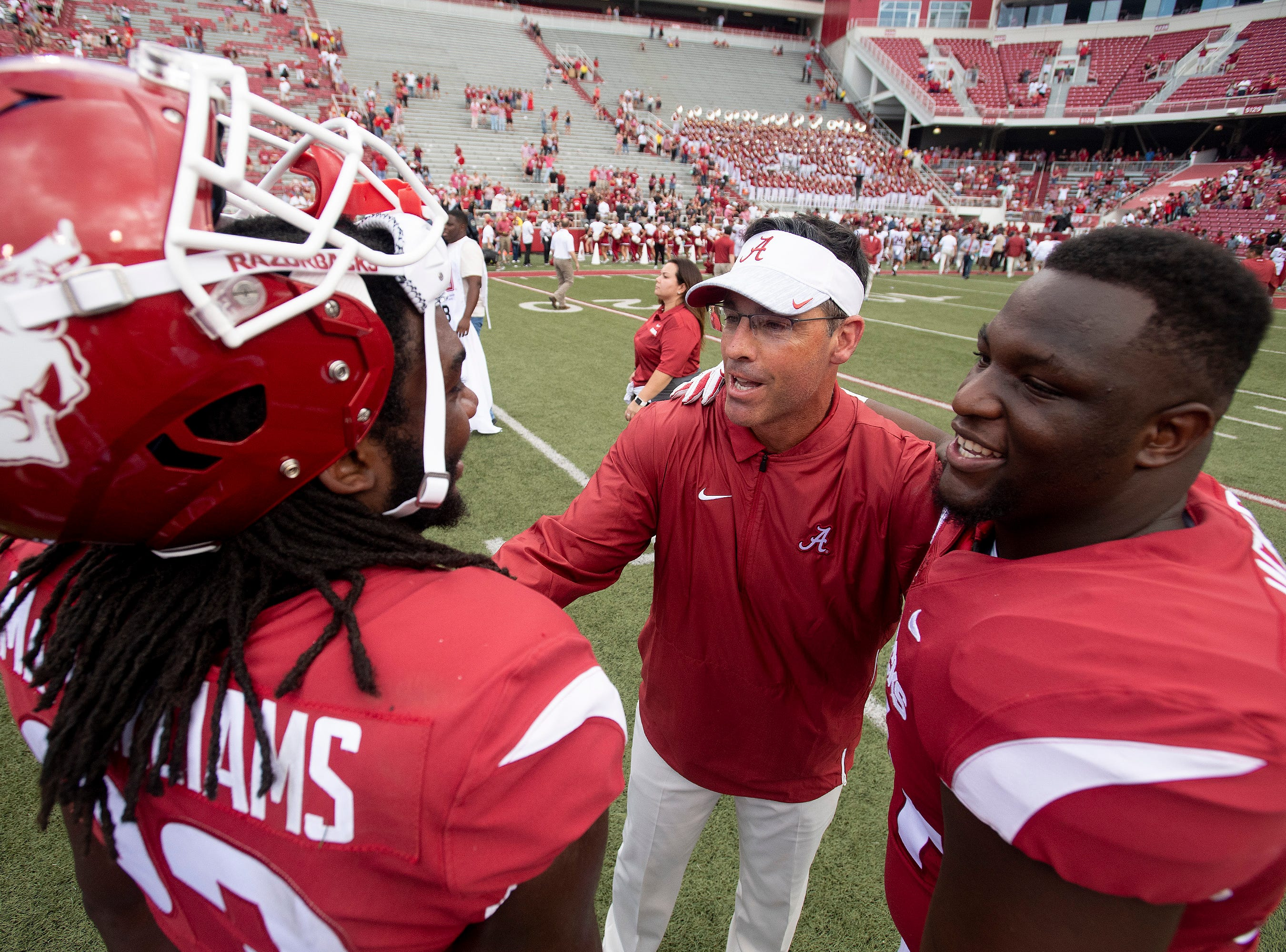Alabama quarterbacks coach Dan Enos greets Arkansas players after the game in Fayetteville, Ark., on Saturday October 6, 2018.