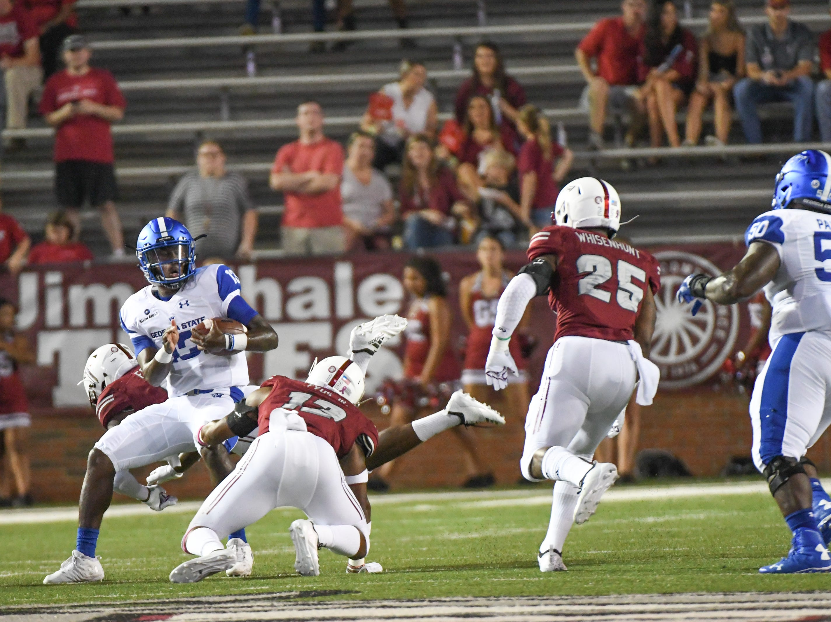 Georgia State Panthers quarterback Dan Ellington (13) is tackled by Troy Trojans safety Melvin Tyus (12) during a game at Veteran's Memorial Stadium in Troy, Ala., on Thursday, Oct. 4, 2018. (Chip Dillard/Special to the Montgomery Advertiser)