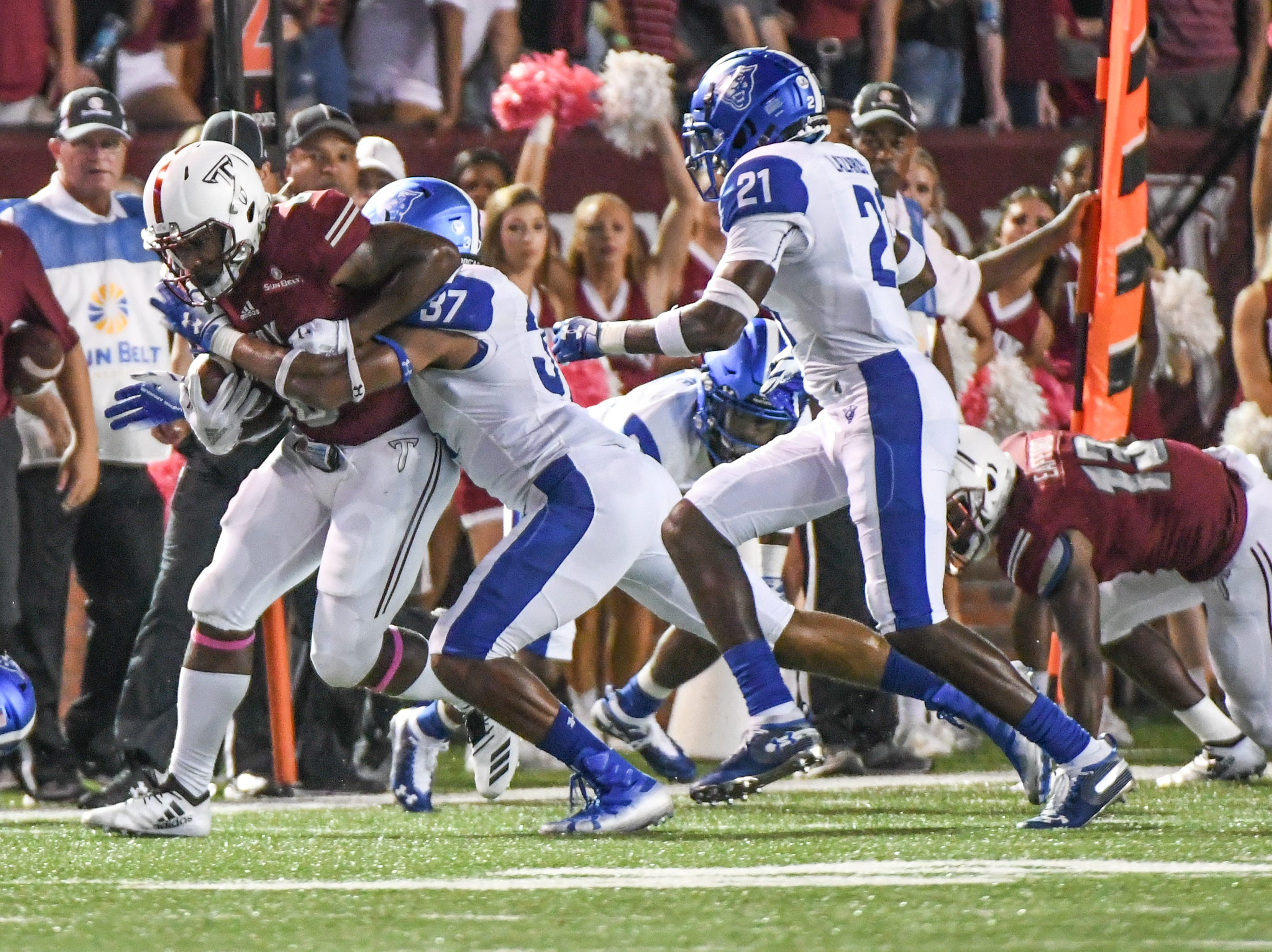 Troy Trojans wide receiver Sidney Davis (6) is tackled by Georgia State Panthers linebacker Victor Heyward (37) during the first half at Veteran's Memorial Stadium in Troy, Ala., on Thursday, Oct. 4, 2018. (Chip Dillard/Special to the Montgomery Advertiser)