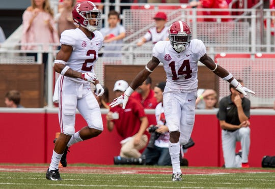 Alabama defensive back Deionte Thompson (14) celebrates recovering an Arkansas fumble near the goal line during first half action in Fayetteville, Ark., on Saturday October 6, 2018.