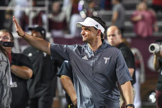 Troy head coach Neal Brown celebrates Troy's win against Georgia State at Veteran's Memorial Stadium in Troy, Ala., on Thursday, Oct. 4, 2018. (Chip Dillard/Special to the Montgomery Advertiser)