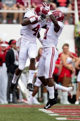 Alabama wide receiver Jerry Jeudy (4) and Alabama wide receiver Henry Ruggs, III, (11) celebrate a Judy touchdown against Arkansas during first half action in Fayetteville, Ark., on Saturday October 6, 2018.