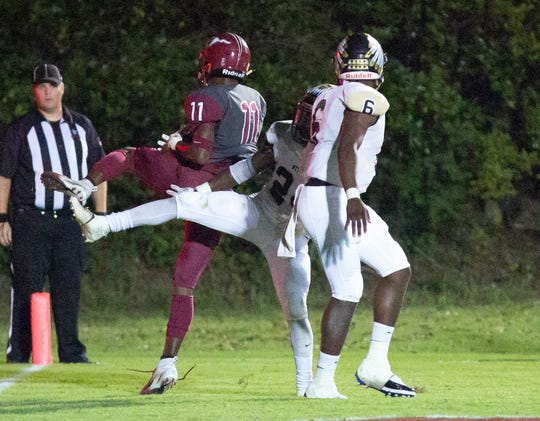 Stanhope's Ali McMillian catches a pass for a two point conversion making up for a missed extra point earlier in the game against Wetumpka.
