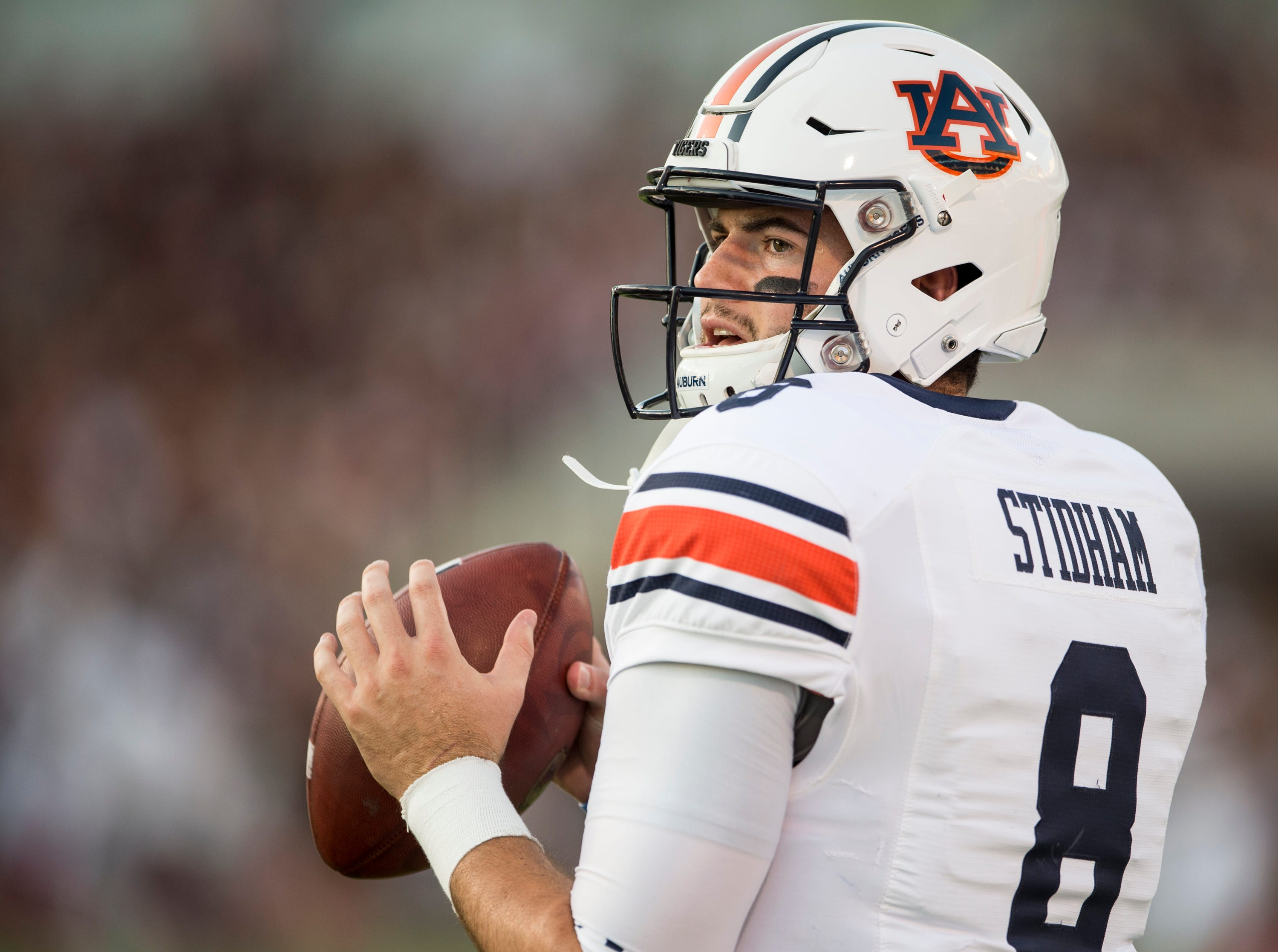 Auburn's Jarrett Stidham (8) warms up at Davis Wade Stadium in Starkville, Miss., on Saturday, Oct. 6, 2018.