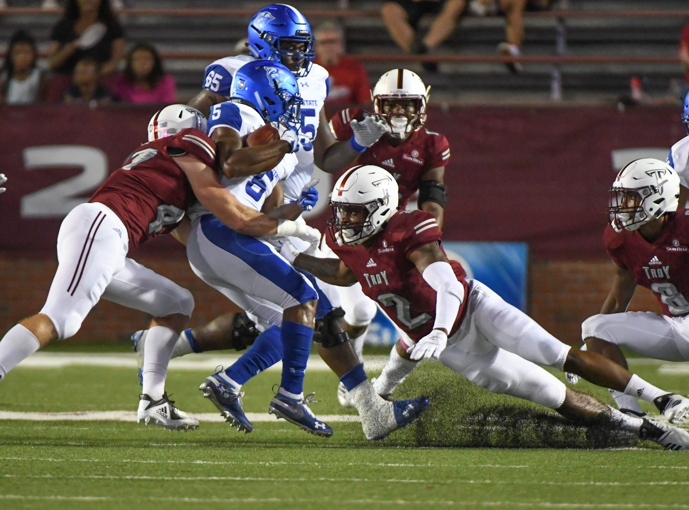 Georgia State Panthers running back Tra Barnett (5) is tackled by Troy Trojans linebacker Hunter Reese (47) during the first half at Veteran's Memorial Stadium in Troy, Ala., on Thursday, Oct. 4, 2018. (Chip Dillard/Special to the Montgomery Advertiser)
