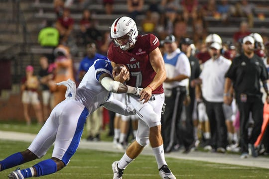 Troy Trojans quarterback Kaleb Barker (7) is tackled by Georgia State Panthers linebacker Jordan Strachan (7) against Georgia State at Veteran's Memorial Stadium in Troy, Ala., on Thursday, Oct. 4, 2018. (Chip Dillard/Special to the Montgomery Advertiser)