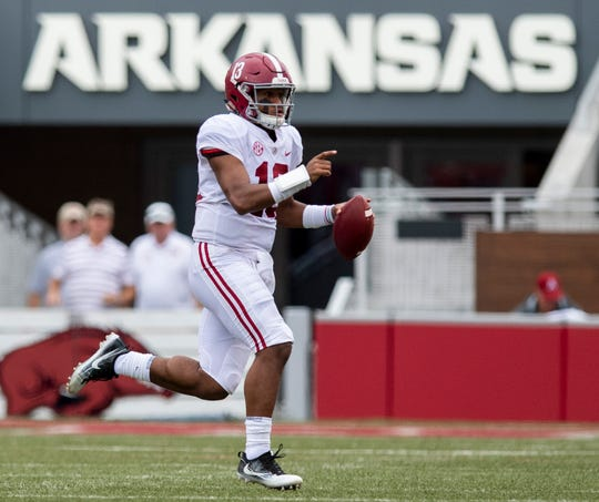 Alabama quarterback Tua Tagovailoa (13) rolls out against Arkansas during first half action in Fayetteville, Ark., on Saturday October 6, 2018.