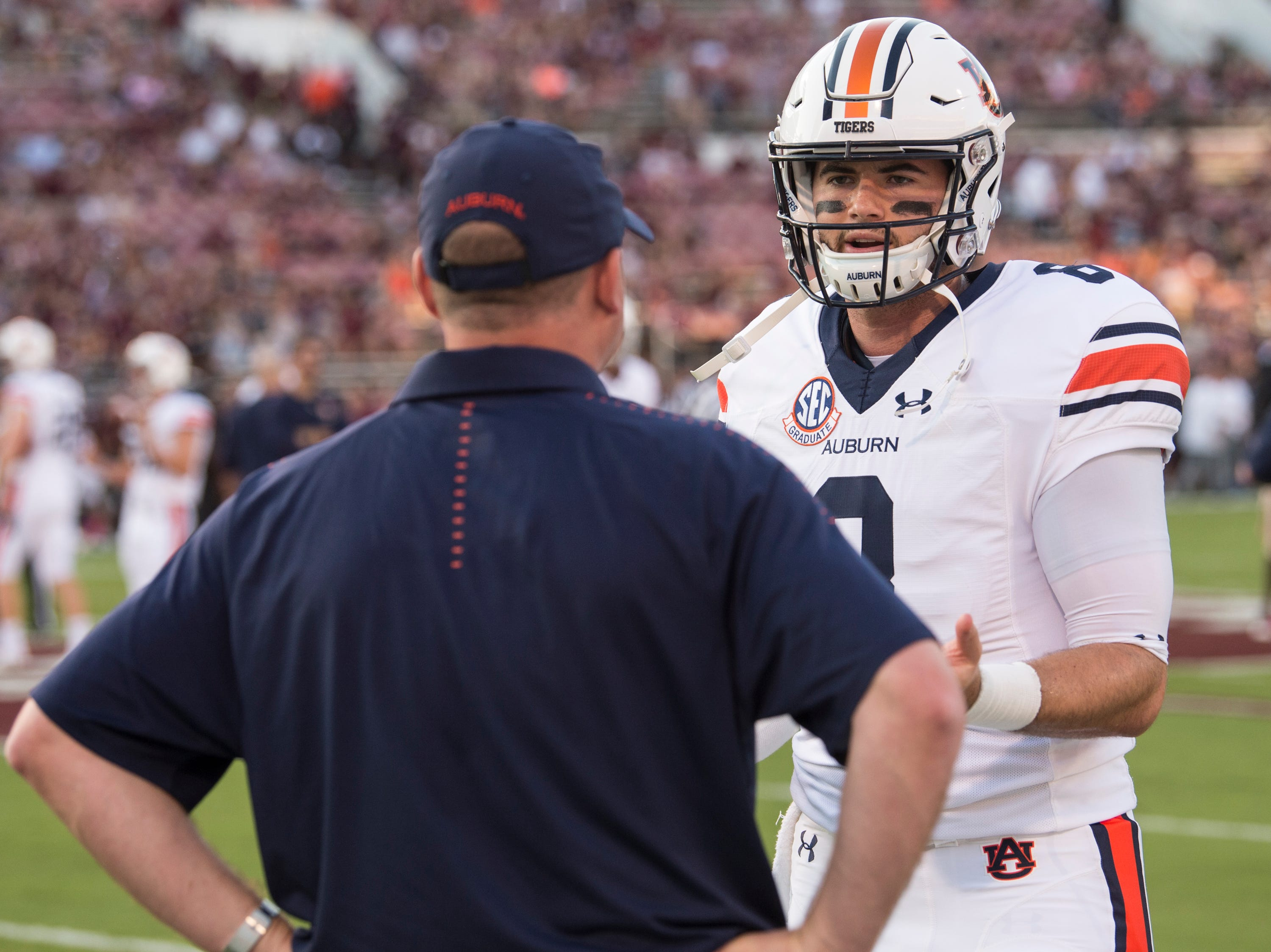 Auburn's Jarrett Stidham (8) talks with Auburn offensive coordinator Chip Lindsey during warm ups at Davis Wade Stadium in Starkville, Miss., on Saturday, Oct. 6, 2018.