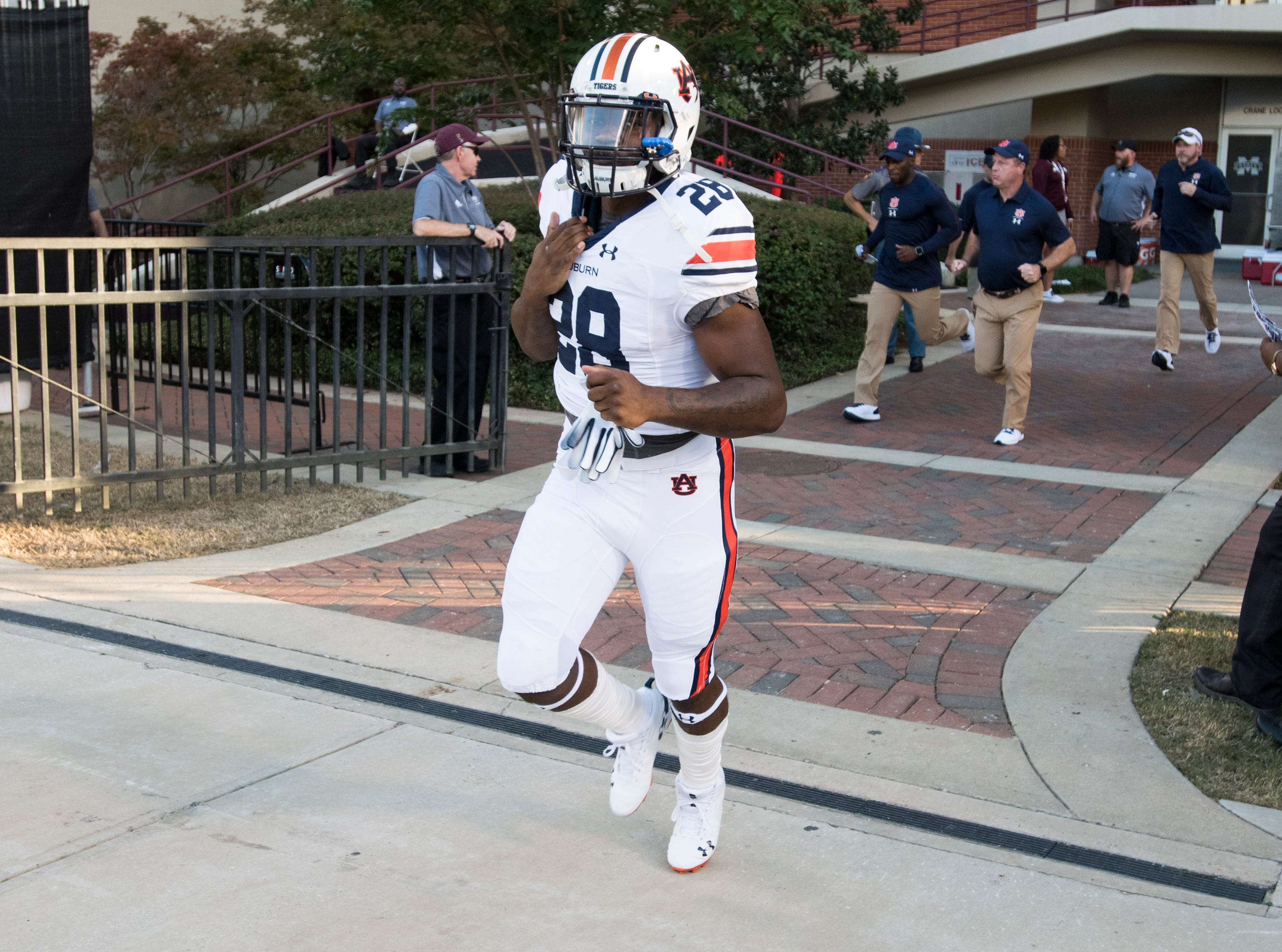 Auburn's JaTarvious Whitlow (28) runs out on to the field for warm ups at Davis Wade Stadium in Starkville, Miss., on Saturday, Oct. 6, 2018.