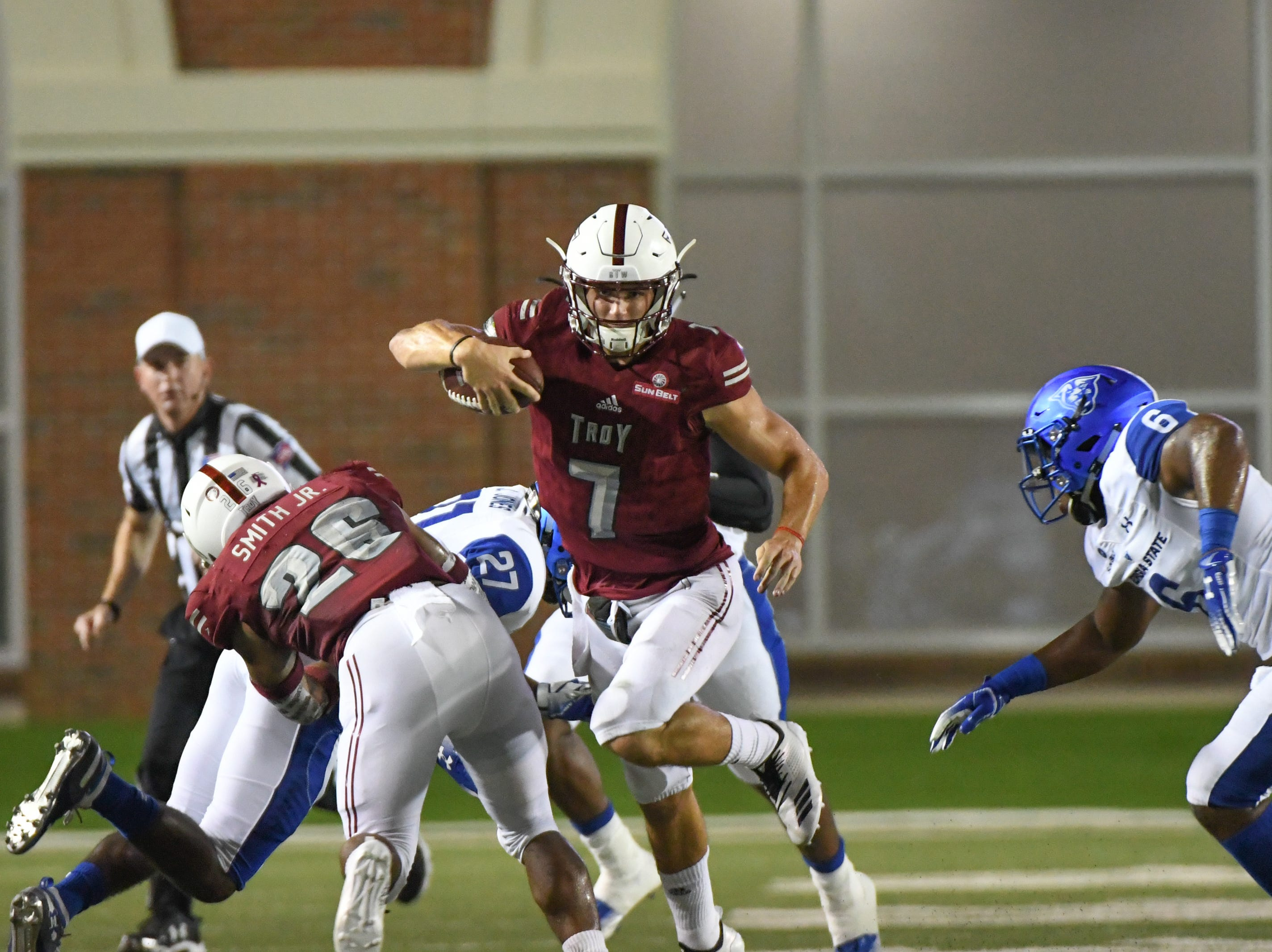 Troy Trojans quarterback Kaleb Barker (7) breaks through for a gain against Georgia State at Veteran's Memorial Stadium in Troy, Ala., on Thursday, Oct. 4, 2018. (Chip Dillard/Special to the Montgomery Advertiser)