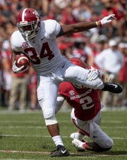 Alabama running back Damien Harris (34) breaks away from Arkansas defensive back Kamren Curl (2) during second half action in Fayetteville, Ark., on Saturday October 6, 2018.