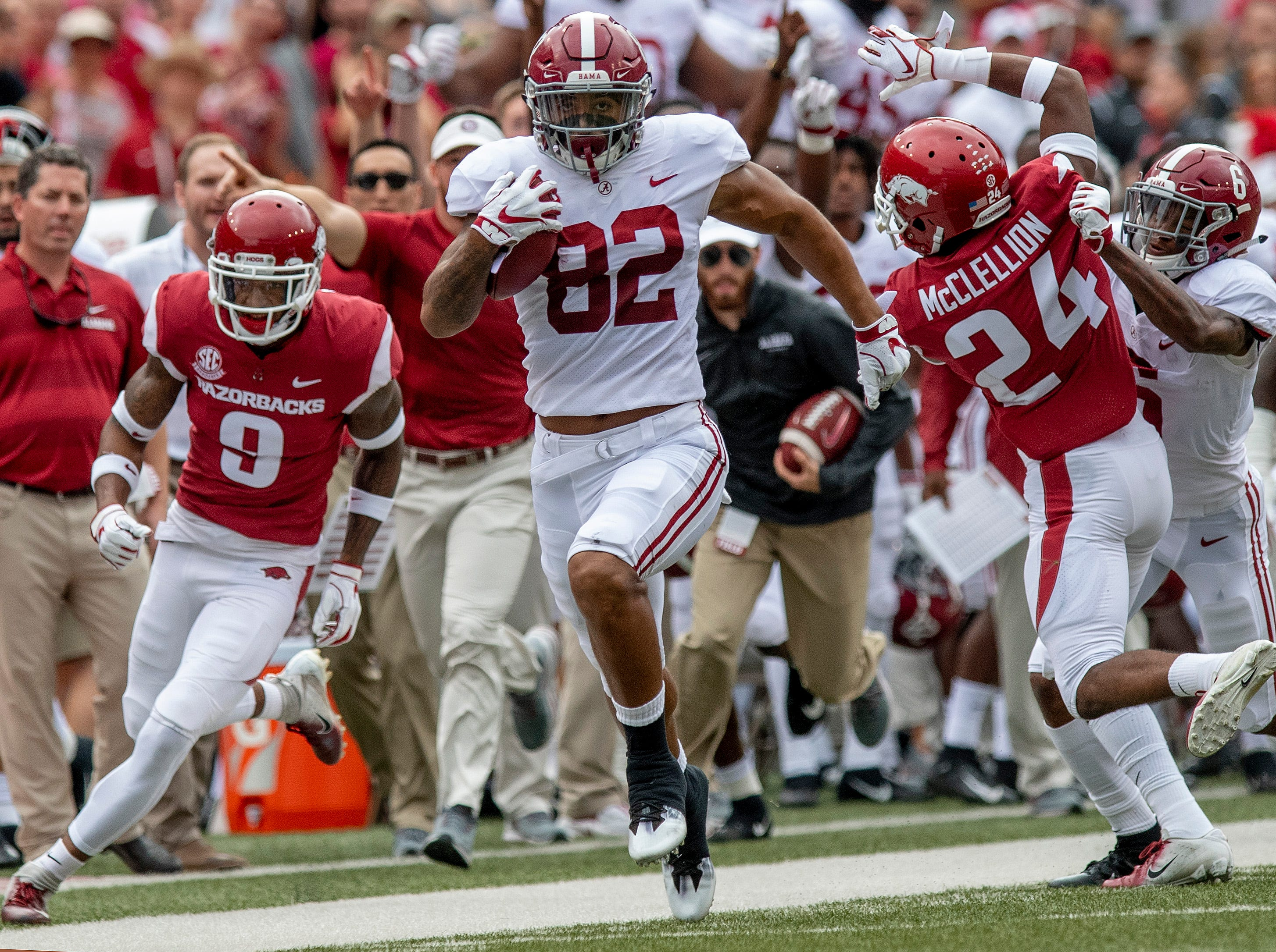 Alabama tight end Irv Smith Jr. (82) breaks free for a log touchdown in the opening minute against against Arkansas in Fayetteville, Ark., on Saturday October 6, 2018.