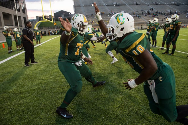 Carver lineman warm up before taking on Northview at Cramton Bowl in Montgomery, Ala., on Friday, Oct. 5, 2018. Carver leads Northview 20-10 at halftime.