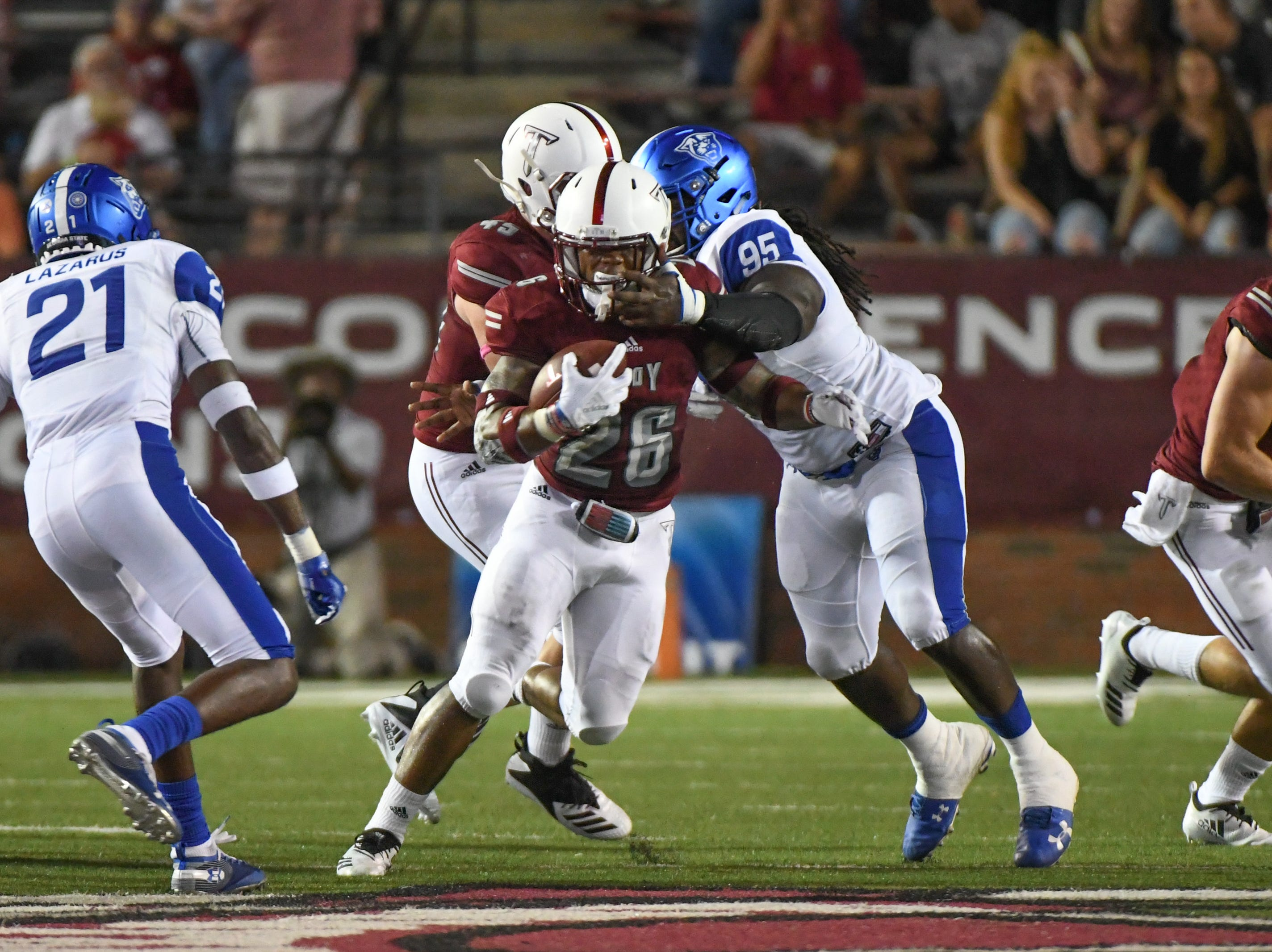 Troy Trojans running back B.J. Smith (26) is tackled by Georgia State Panthers defensive end Marterious Allen (95) during the first half at Veteran's Memorial Stadium in Troy, Ala., on Thursday, Oct. 4, 2018. (Chip Dillard/Special to the Montgomery Advertiser)