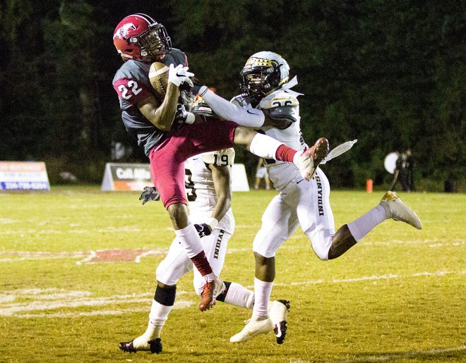 Stanhope's Blake Durham catches a long and high pass to him as Wetumpka's Hezekiah Nowden tries to intercept it.