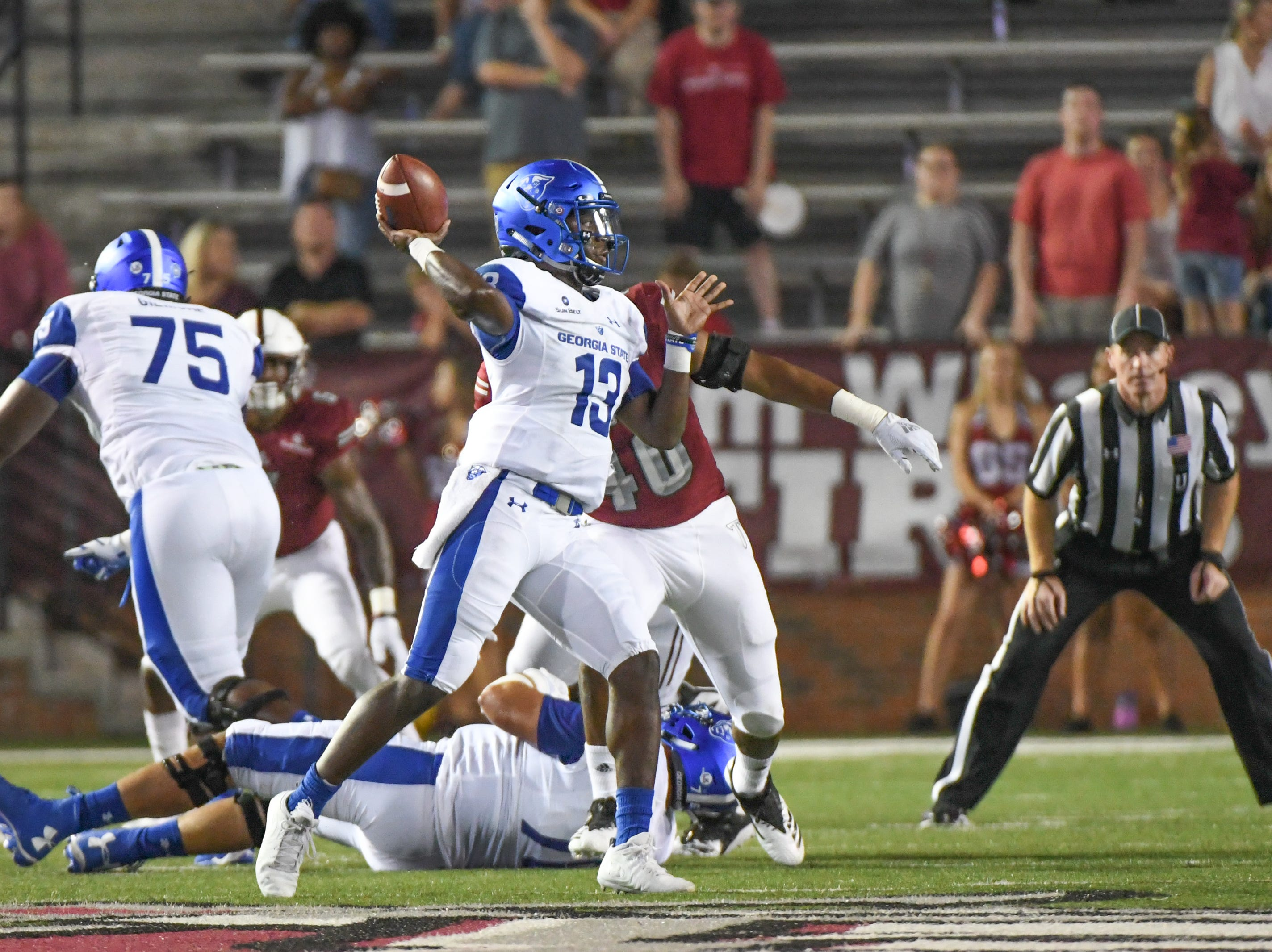Georgia State Panthers quarterback Dan Ellington (13) drops back to pass at Veteran's Memorial Stadium in Troy, Ala., on Thursday, Oct. 4, 2018. (Chip Dillard/Special to the Montgomery Advertiser)