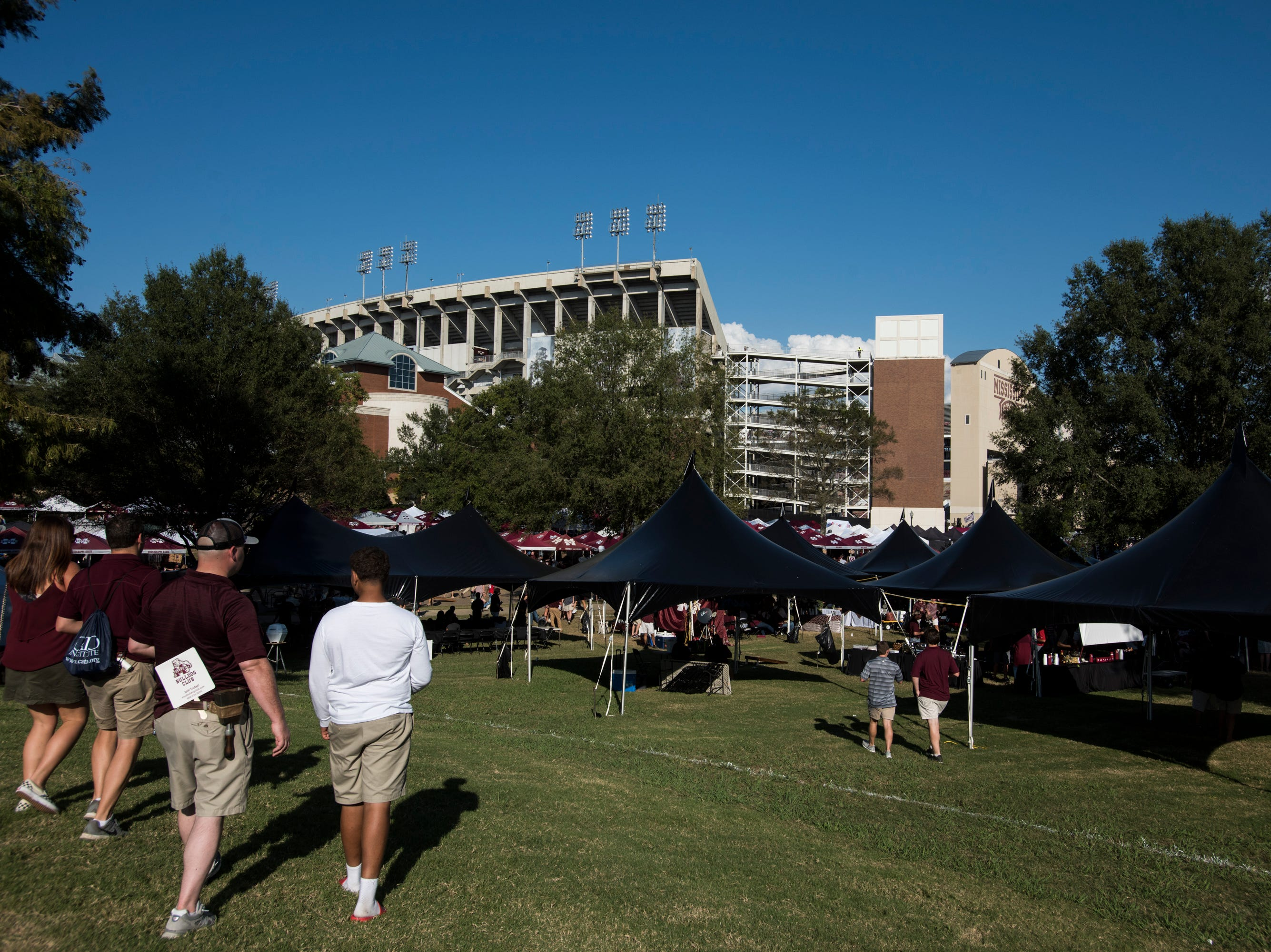 Fans walk toward the game outside Davis Wade Stadium in Starkville, Miss., on Saturday, Oct. 6, 2018.