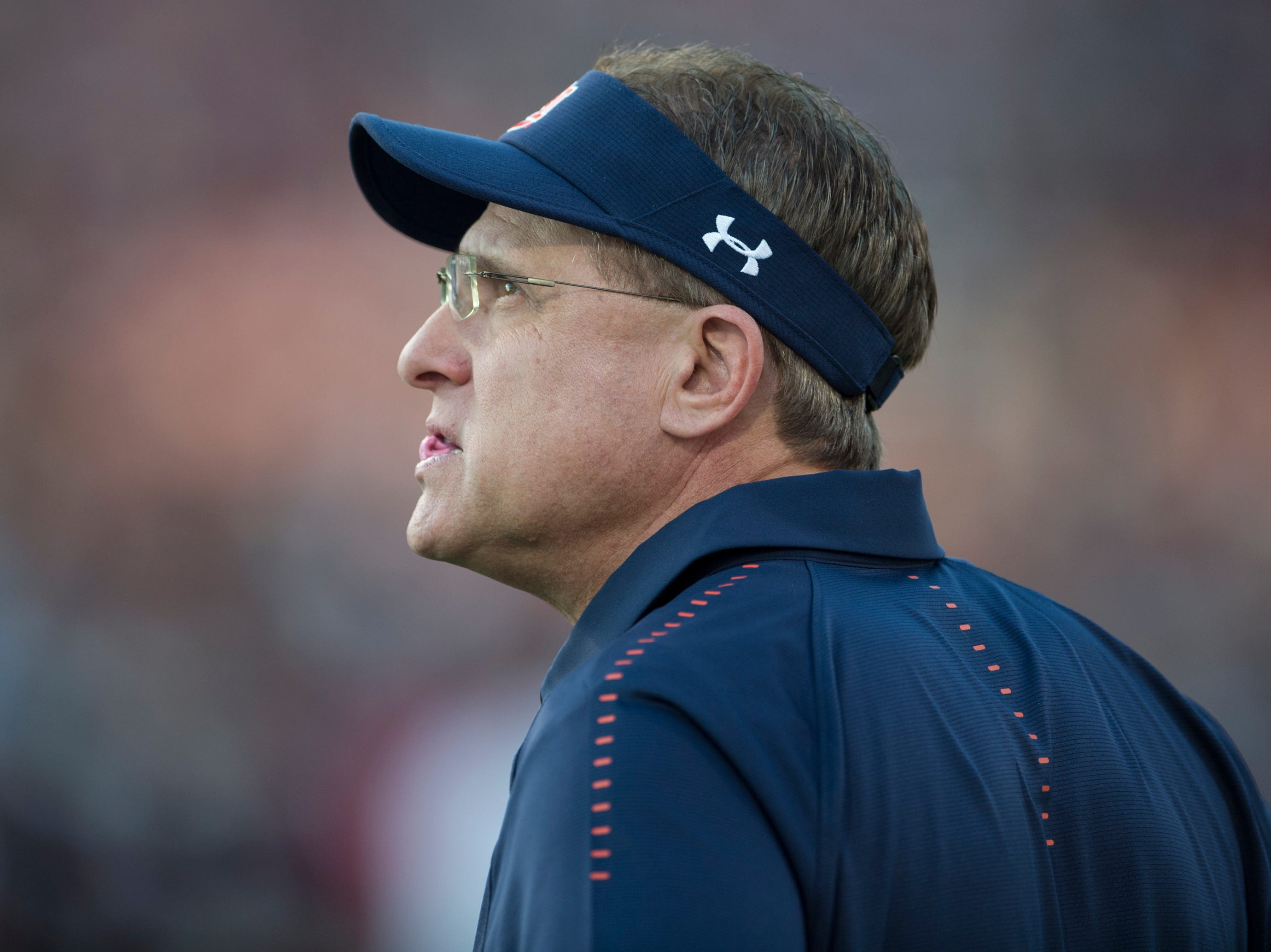 Auburn head coach Gus Malzahn chews gum as he watches his team warm up at Davis Wade Stadium in Starkville, Miss., on Saturday, Oct. 6, 2018.