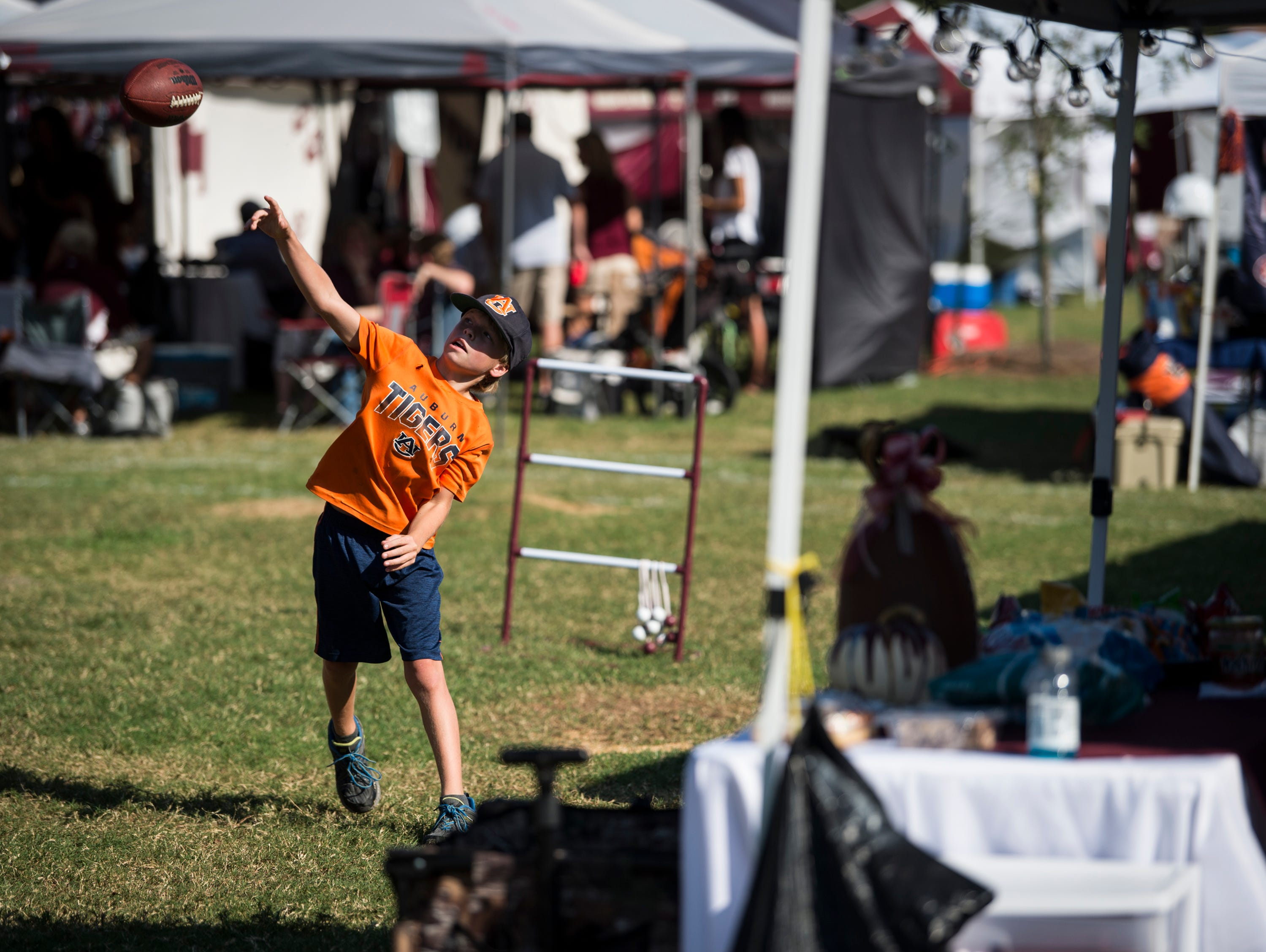 Tyler Kauffman, 11, plays catch outside Davis Wade Stadium in Starkville, Miss., on Saturday, Oct. 6, 2018.