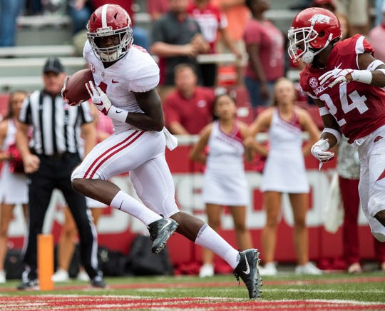 Alabama wide receiver Jerry Jeudy (4) beats Arkansas defensive back Jarques McClellion (24) on a touchdown reception during first half action in Fayetteville, Ark., on Saturday October 6, 2018.