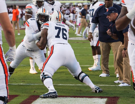 Auburn's Prince Tega Wanogho (76) warms up at Davis Wade Stadium in Starkville, Miss., on Saturday, Oct. 6, 2018.