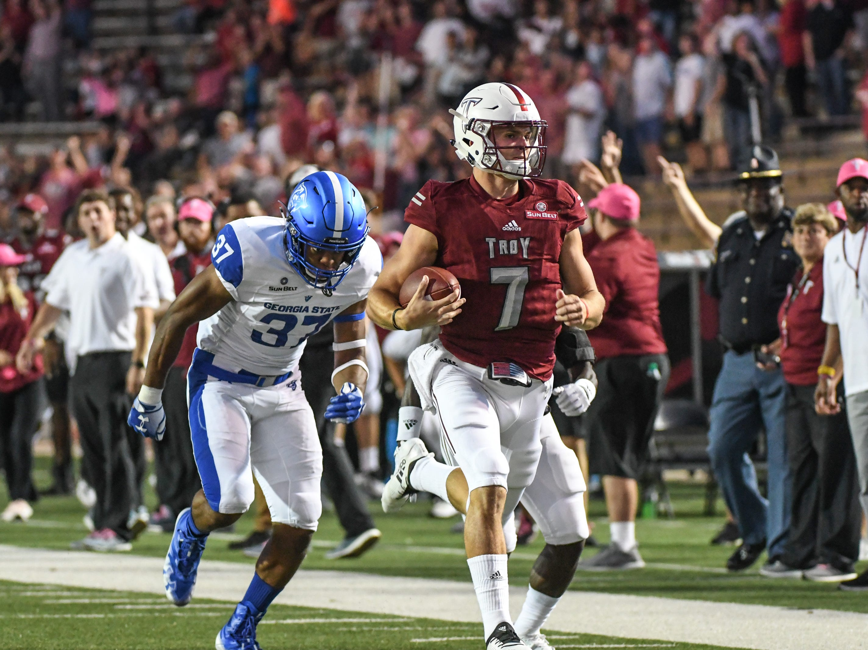 Troy Trojans quarterback Kaleb Barker (7) runs down the field for huge gain during the first half against Georgia State at Veteran's Memorial Stadium in Troy, Ala., on Thursday, Oct. 4, 2018. (Chip Dillard/Special to the Montgomery Advertiser)