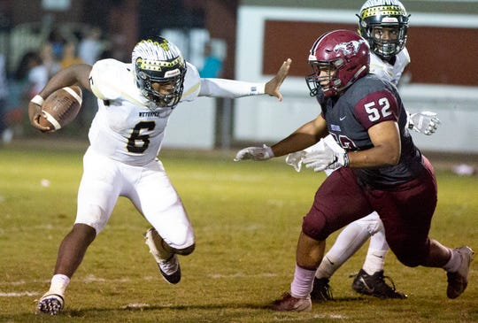 Wetumpka's Tyquan Rawls tries to stave off Stanhope's Ladorian Leonard.