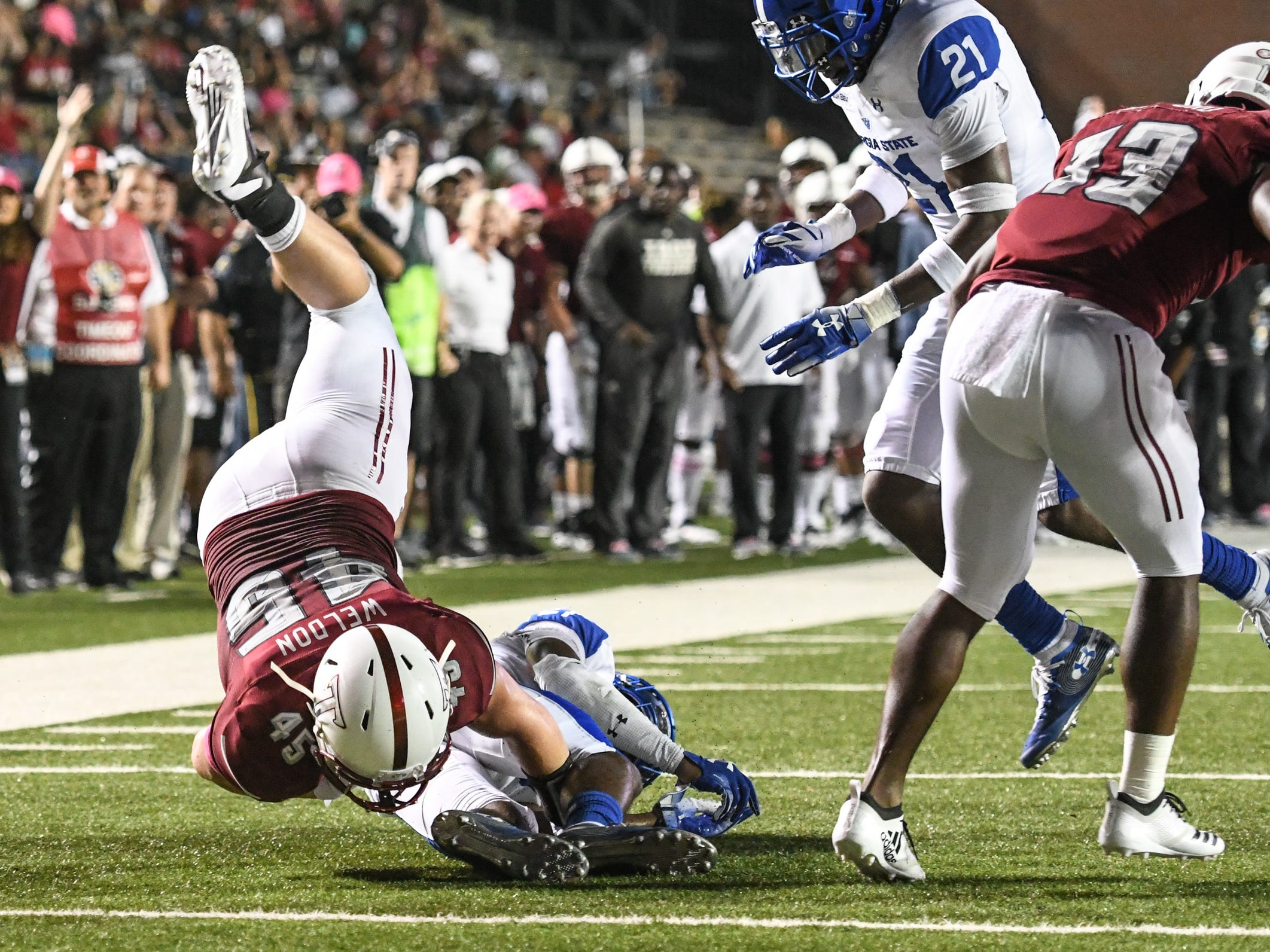 Troy Trojans fullback Zacc Weldon (45) dives to the one-yard line against Georgia State at Veteran's Memorial Stadium in Troy, Ala., on Thursday, Oct. 4, 2018. (Chip Dillard/Special to the Montgomery Advertiser)