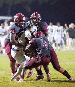 Wetumpka's Dvenio Davis is surrounded by Stanhope players before the ball is stripped from him by Marlon Hunt.