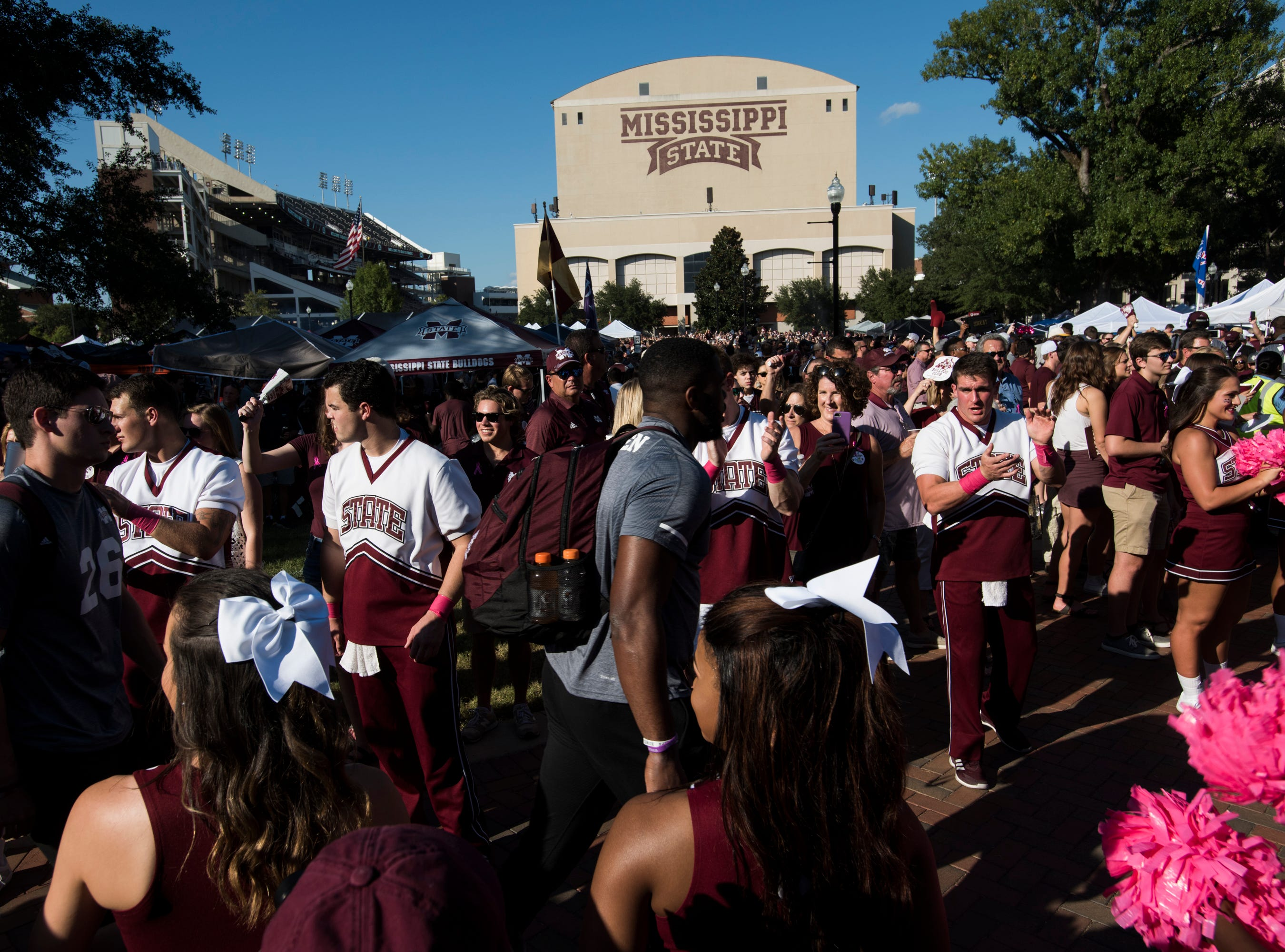 Mississippi State players high five fans during the Dawg Walk outside Davis Wade Stadium in Starkville, Miss., on Saturday, Oct. 6, 2018.