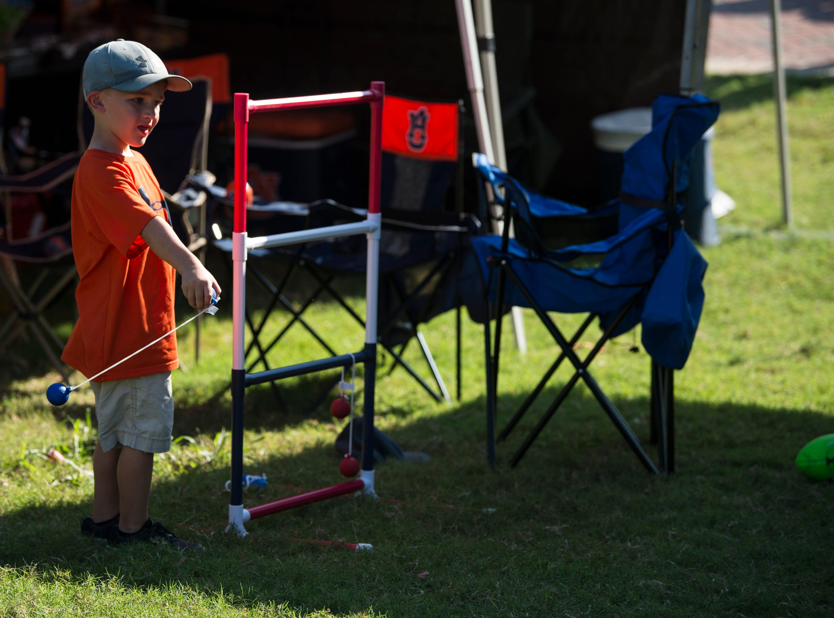 Hudson Holt, 5, plays tailgate games with his family outside Davis Wade Stadium in Starkville, Miss., on Saturday, Oct. 6, 2018.