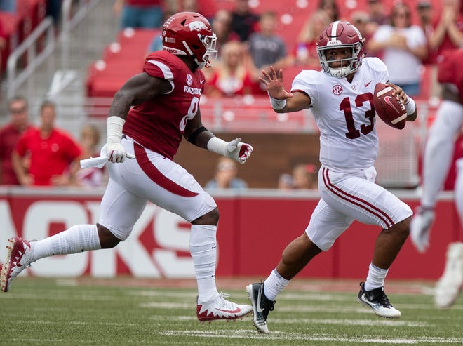 Alabama quarterback Tua Tagovailoa (13) carries the ball against Arkansas during first half action in Fayetteville, Ark., on Saturday October 6, 2018.