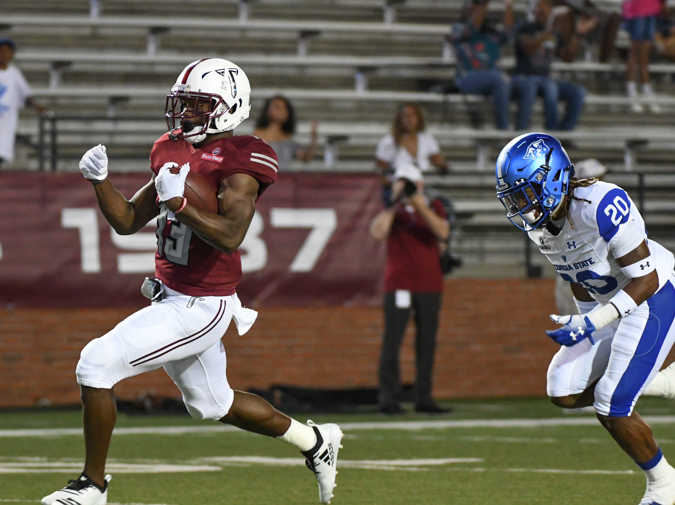Troy Trojans wide receiver Tray Eafford (13) scores a touchdown against Georgia State at Veteran's Memorial Stadium in Troy, Ala., on Thursday, Oct. 4, 2018. (Chip Dillard/Special to the Montgomery Advertiser)