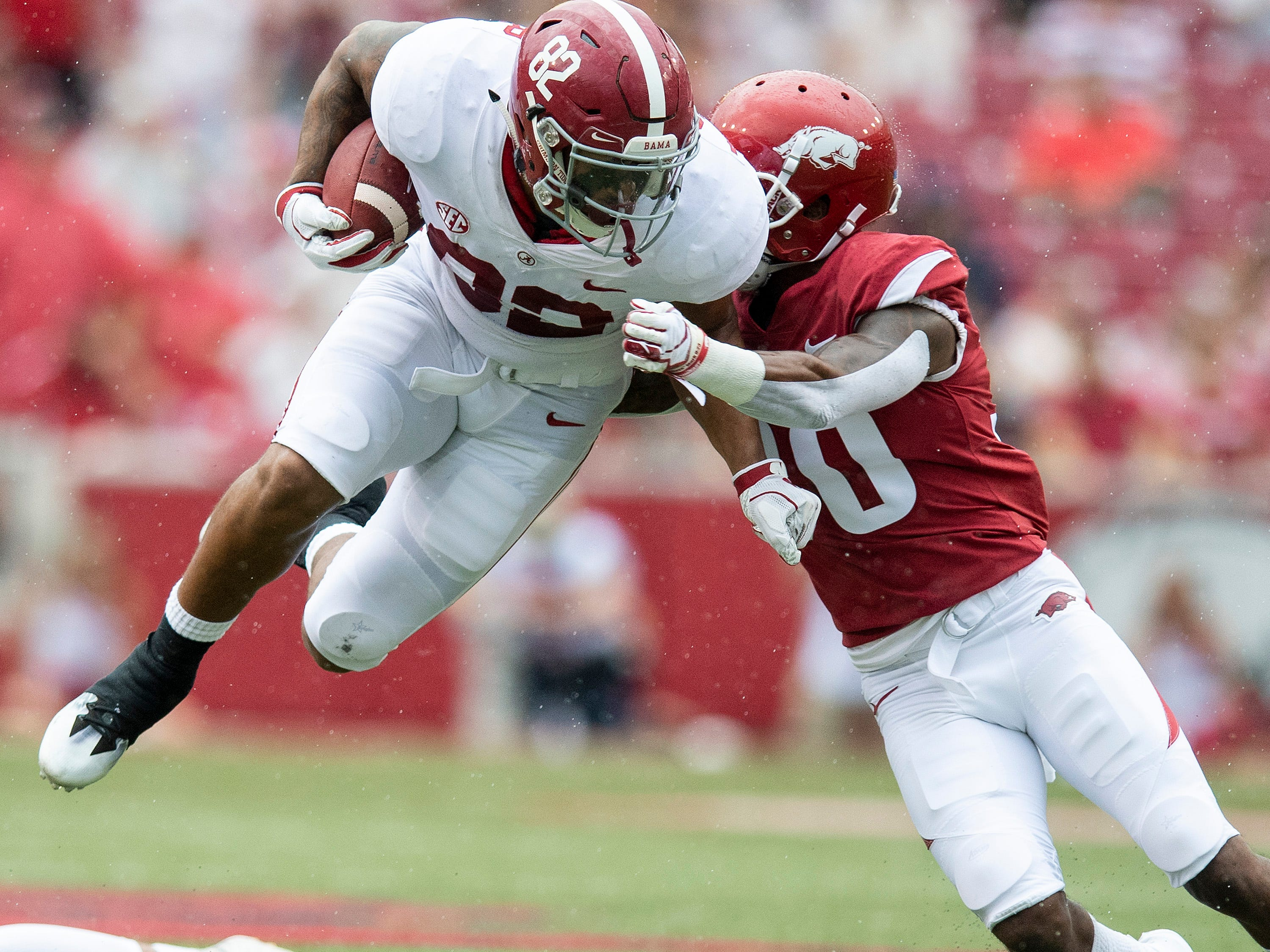 Alabama tight end Irv Smith Jr. (82) collides with Arkansas defensive back Kevin Richardson, II, (30) during first half action in Fayetteville, Ark., on Saturday October 6, 2018.