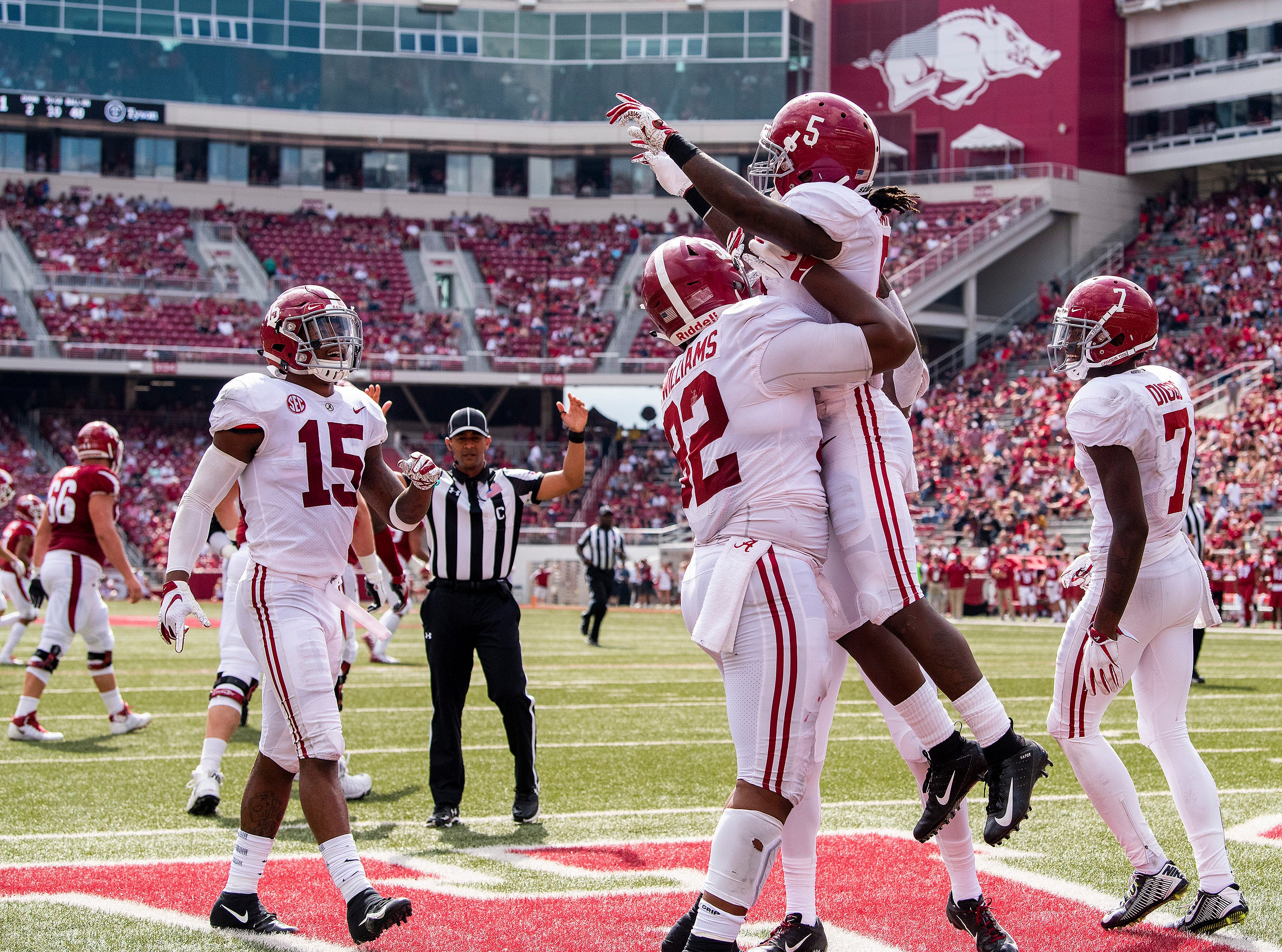 Alabama defensive lineman Quinnen Williams (92) lifts Alabama defensive back Shyheim Carter (5) after Carters interception return for touchdown against Arkansas during second half action in Fayetteville, Ark., on Saturday October 6, 2018.