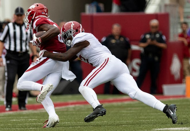 Alabama defensive back Trevon Diggs (7) tackles Arkansas wide receiver Michael Woods (8) during first half action in Fayetteville, Ark., on Saturday October 6, 2018.