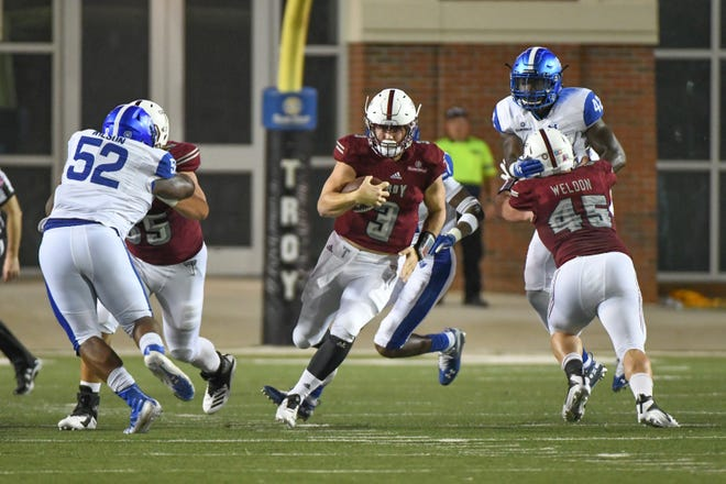 Troy Trojans quarterback Sawyer Smith (3) breaks away against Georgia State at Veteran's Memorial Stadium in Troy, Ala., on Thursday, Oct. 4, 2018. (Chip Dillard/Special to the Montgomery Advertiser)