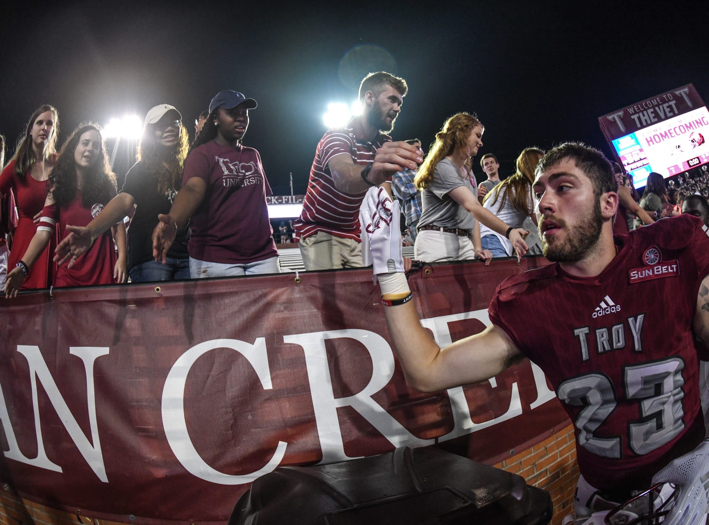Troy Trojans wide receiver Bret Clark (23) celebrates with the Troy student section against Georgia State at Veteran's Memorial Stadium in Troy, Ala., on Thursday, Oct. 4, 2018. (Chip Dillard/Special to the Montgomery Advertiser)