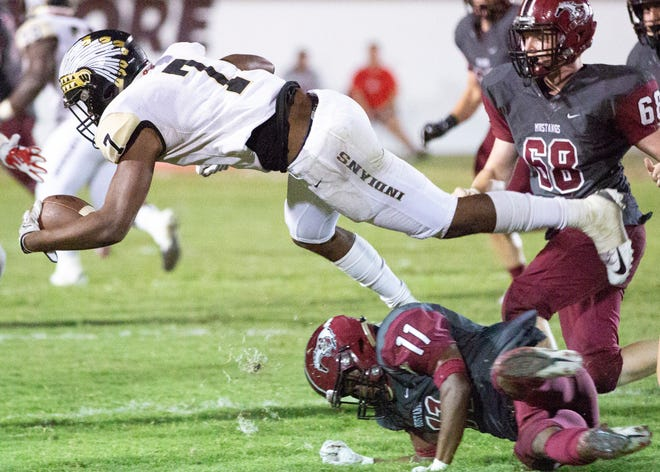 Wetumpka's Darren Nolan goes horizontal after tripping over Stanhope's Ali McMillan during a tackle.